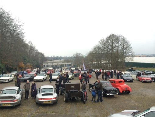 Porsches, Model T Ford hot rods and Riley 1.5 on the start finish straight at the 2015 Brooklands New Year's Day meeting