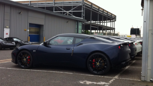 A new Evora at Hethel with the part finished and now abandoned Esprit plant behind